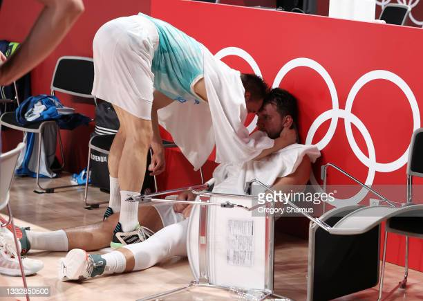 Luka Doncic of Team Slovenia os consoled by teammate Jaka Blazic following their loss to Team Australia in the Men's Basketball Bronze medal game on...