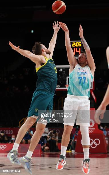 Luka Doncic of Team Slovenia shoots against Nic Kay of Team Australia during the second half of the Men's Basketball Bronze medal game on day fifteen...