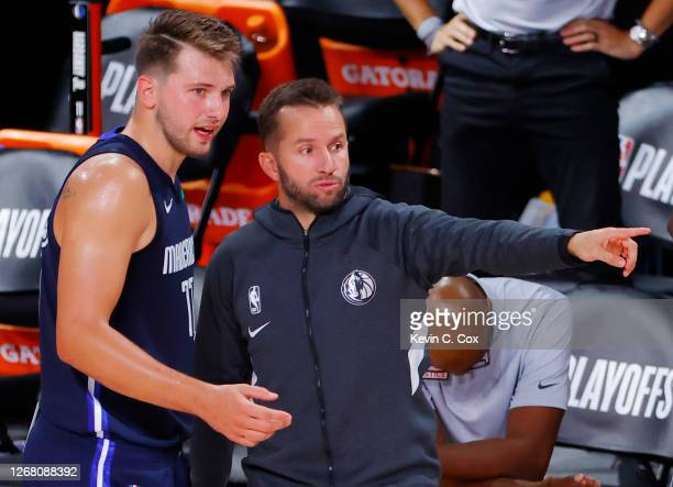 Luka Doncic of the Dallas Mavericks and J.J. Barea talk during the fourth quarter against the LA Clippers in Game Four of the Western Conference...