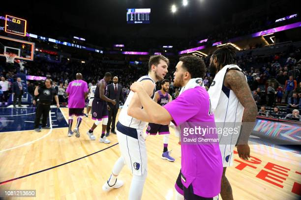 Luka Doncic of the Dallas Mavericks and Tyus Jones of the Minnesota Timberwolves hug after the game on January 11, 2019 at Target Center in...