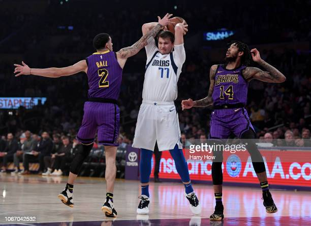 Luka Doncic of the Dallas Mavericks attempts a pass between Lonzo Ball and Brandon Ingram of the Los Angeles Lakers during the first half at Staples...