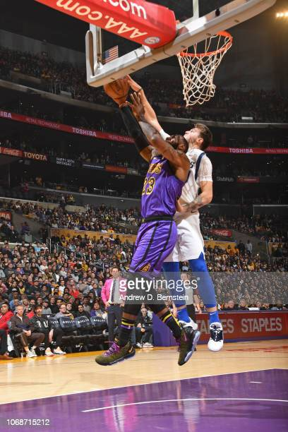 Luka Doncic of the Dallas Mavericks blocks the shot of LeBron James of the Los Angeles Lakers on November 30 2018 at STAPLES Center in Los Angeles...