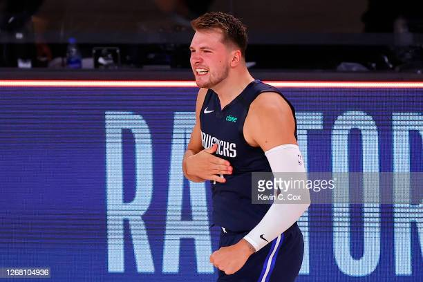 Luka Doncic of the Dallas Mavericks celebrates a game winning three point basket against the LA Clippers during overtime in Game Four of the Western...