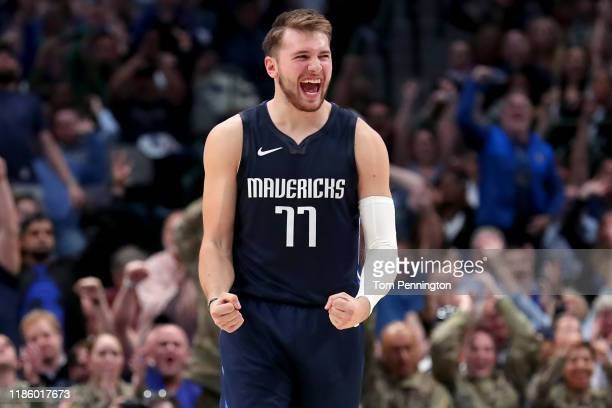 Luka Doncic of the Dallas Mavericks celebrates after the Dallas Mavericks scored against the Orlando Magic in the second half at American Airlines...