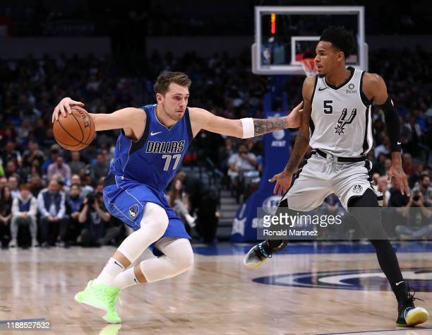 Luka Doncic of the Dallas Mavericks dribbles the ball against Dejounte Murray of the San Antonio Spurs in the first half at American Airlines Center...