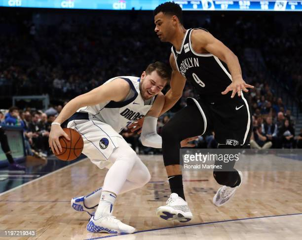 Luka Doncic of the Dallas Mavericks dribbles the ball against Timothe LuwawuCabarrot of the Brooklyn Nets at American Airlines Center on January 02...