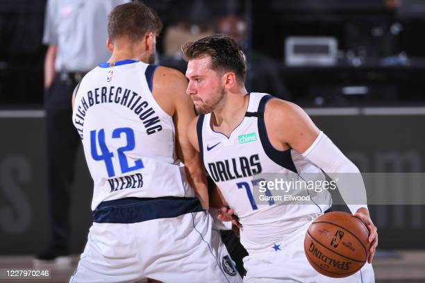 Luka Doncic of the Dallas Mavericks dribbles the ball around a screen against the Milwaukee Bucks on August 8, 2020 in Orlando, Florida at...
