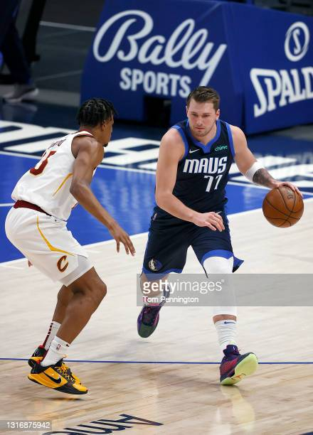 Luka Doncic of the Dallas Mavericks dribbles the ball downcourt against Isaac Okoro of the Cleveland Cavaliers in the first quarter at American...