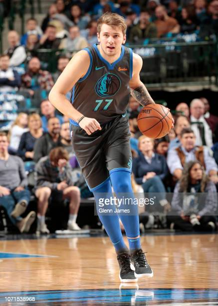Luka Doncic of the Dallas Mavericks dribbles the ball during the game against the Orlando Magic on December 10 2018 at the American Airlines Center...