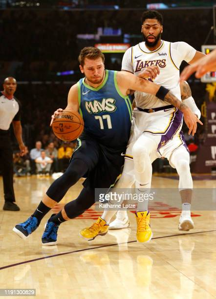 Luka Doncic of the Dallas Mavericks drives around Anthony Davis of the Los Angeles Lakers during the first half at Staples Center on December 01 2019...
