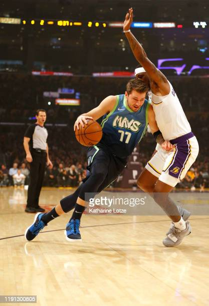 Luka Doncic of the Dallas Mavericks drives around Kentavious CaldwellPope of the Los Angeles Lakers during the first half at Staples Center on...