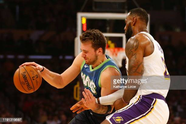 Luka Doncic of the Dallas Mavericks drives around LeBron James of the Los Angeles Lakers during the first half at Staples Center on December 01 2019...