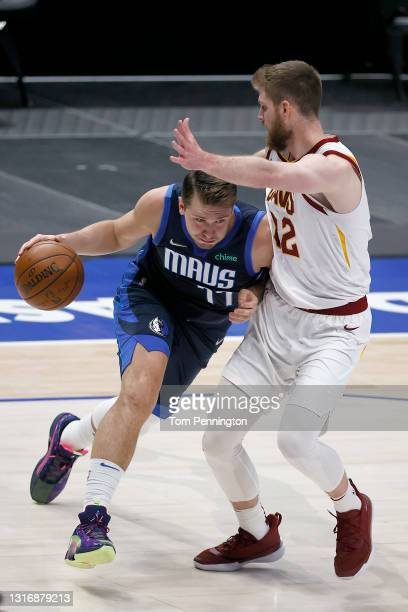 Luka Doncic of the Dallas Mavericks drives to the basket against Dean Wade of the Cleveland Cavaliers in the second quarter at American Airlines...