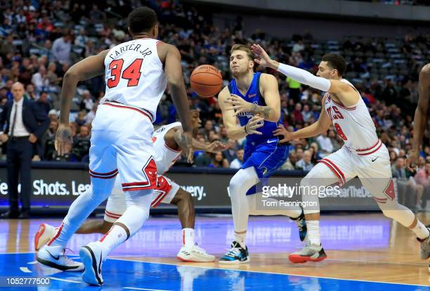 Luka Doncic of the Dallas Mavericks drives to the basket against Wendell Carter Jr #34 of the Chicago Bulls and Zach LaVine of the Chicago Bulls in...