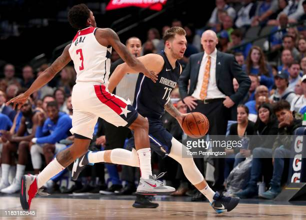 Luka Doncic of the Dallas Mavericks drives to the basket against Bradley Beal of the Washington Wizards in the second half at American Airlines...