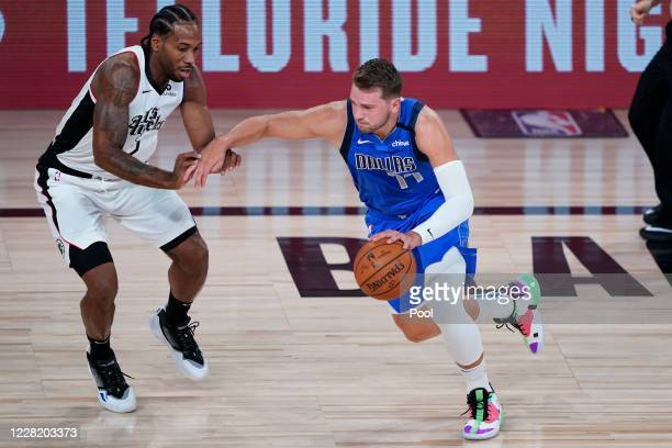 Luka Doncic of the Dallas Mavericks drives to the basket against Kawhi Leonard of the LA Clippers in the first half in game five of the first round...