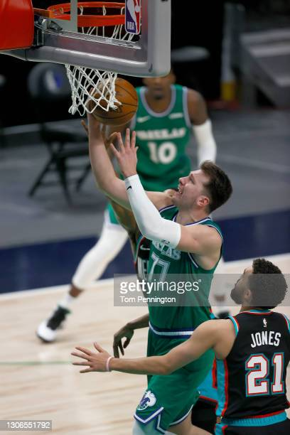 Luka Doncic of the Dallas Mavericks drives to the basket against Tyus Jones of the Memphis Grizzlies in the second half at American Airlines Center...