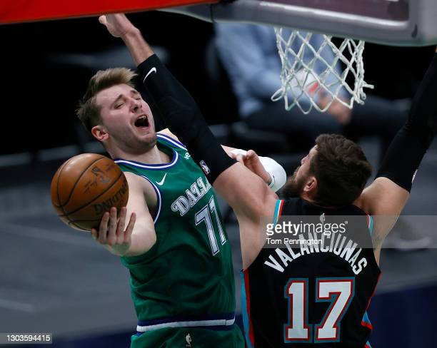 Luka Doncic of the Dallas Mavericks drives to the basket and draws the foul against Jonas Valanciunas of the Memphis Grizzlies in the second half at...
