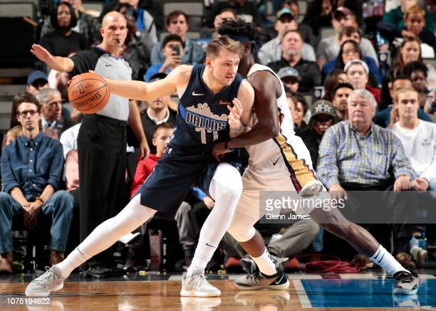 Luka Doncic of the Dallas Mavericks fights for position against the New Orleans Pelicans on December 26 2018 at the American Airlines Center in...