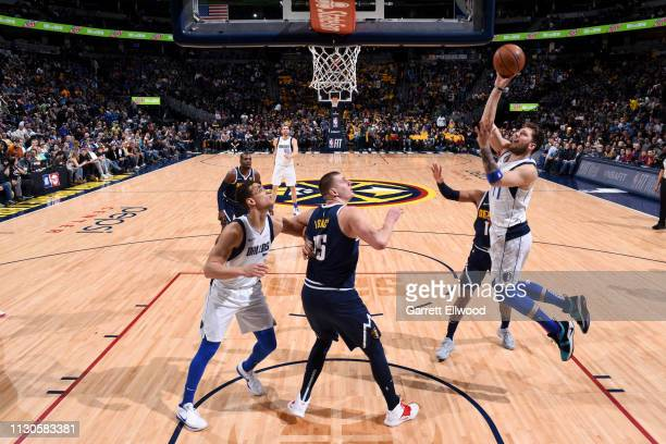 Luka Doncic of the Dallas Mavericks goes to the basket against the Denver Nuggets on March 14 2019 at the Pepsi Center in Denver Colorado NOTE TO...
