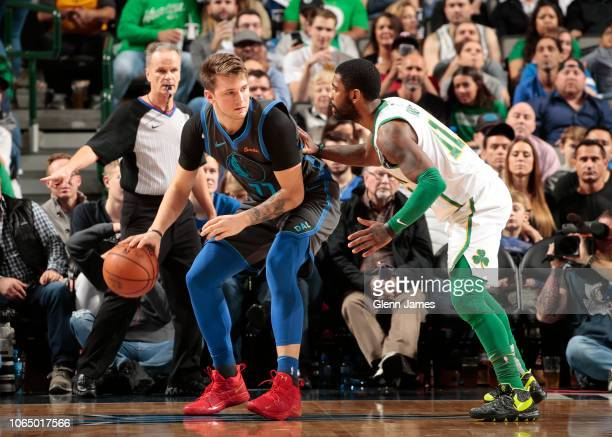 Luka Doncic of the Dallas Mavericks handles the ball against Kyrie Irving of the Boston Celtics on November 24 2018 at the American Airlines Center...