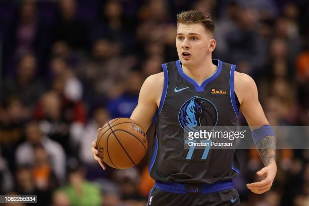 Luka Doncic of the Dallas Mavericks handles the ball during the first half of the NBA game against the Phoenix Suns at Talking Stick Resort Arena on...