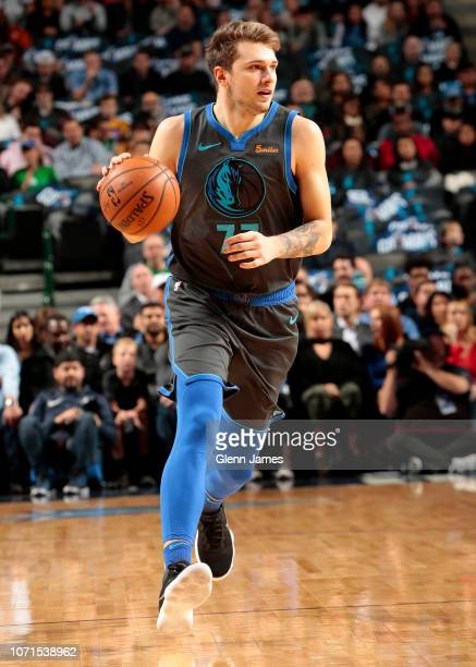 Luka Doncic of the Dallas Mavericks handles the ball during the game against the Orlando Magic on December 10 2018 at the American Airlines Center in...