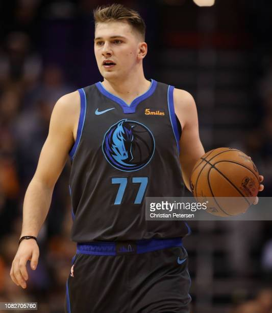 Luka Doncic of the Dallas Mavericks handles the ball during the NBA game against the Phoenix Suns at Talking Stick Resort Arena on December 13 2018...