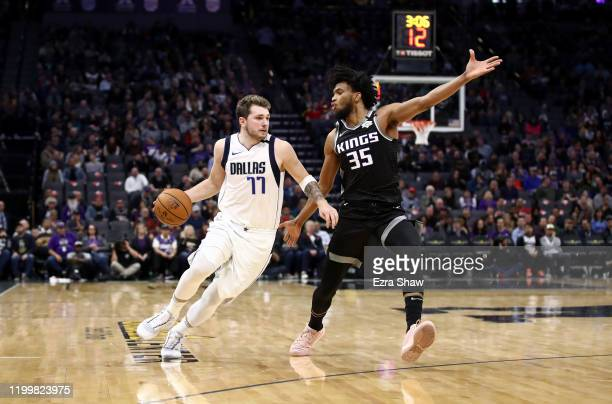 Luka Doncic of the Dallas Mavericks is guarded by Marvin Bagley III of the Sacramento Kings at Golden 1 Center on January 15, 2020 in Sacramento,...