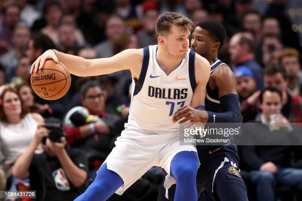 Luka Doncic of the Dallas Mavericks is guarded by Torrey Craig of the Denver Nuggets at the Pepsi Center on December 18 2018 in Denver Colorado NOTE...