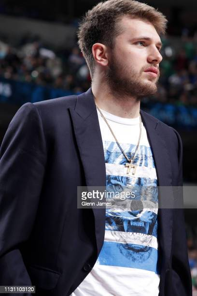 Luka Doncic of the Dallas Mavericks looks on during the game against the Cleveland Cavaliers on March 16 2019 at the American Airlines Center in...