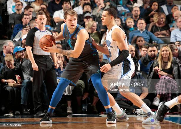 Luka Doncic of the Dallas Mavericks looks to pass the ball during the game against the Orlando Magic on December 10 2018 at the American Airlines...
