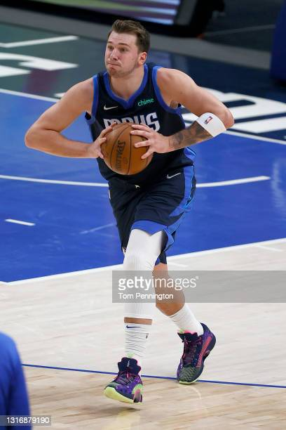 Luka Doncic of the Dallas Mavericks passes the ball against the Cleveland Cavaliers in the second quarter at American Airlines Center on May 07, 2021...