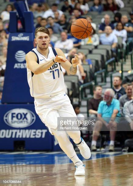 Luka Doncic of the Dallas Mavericks passes the ball in a preseason game against the Beijing Ducks at American Airlines Center on September 29 2018 in...