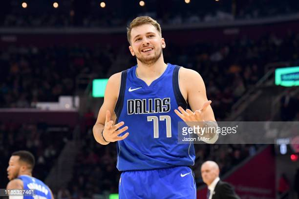 Luka Doncic of the Dallas Mavericks reacts after hitting a three during the first half against the Cleveland Cavaliers at Rocket Mortgage Fieldhouse...