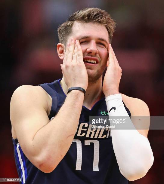 Luka Doncic of the Dallas Mavericks reacts after missing the gamewinning shot in the final seconds against the Chicago Bulls at the United Center on...