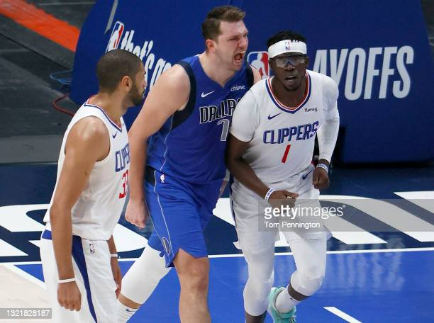 Luka Doncic of the Dallas Mavericks reacts after scoring against Reggie Jackson of the LA Clippers and Nicolas Batum of the LA Clippers in the third...