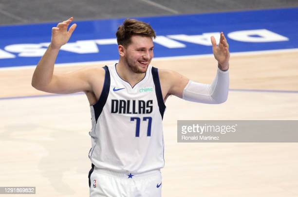 Luka Doncic of the Dallas Mavericks reacts against the Minnesota Timberwolves in the second half during a preseason game at American Airlines Center...