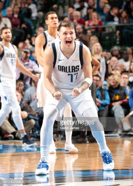 Luka Doncic of the Dallas Mavericks reacts to a play during the game against the Atlanta Hawks on December 12 2018 at the American Airlines Center in...