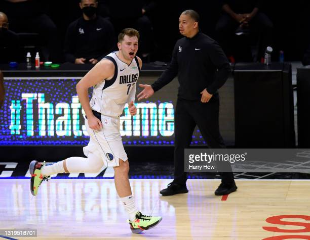 Luka Doncic of the Dallas Mavericks reacts to his three pointer with Tyronn Lue of the LA Clippers in the third quarter during game one of the...