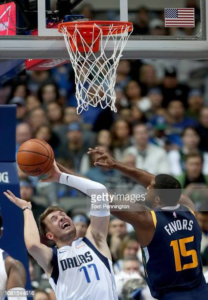 Luka Doncic of the Dallas Mavericks rebounds the ball against Derrick Favors of the Utah Jazz in the first half at American Airlines Center on...