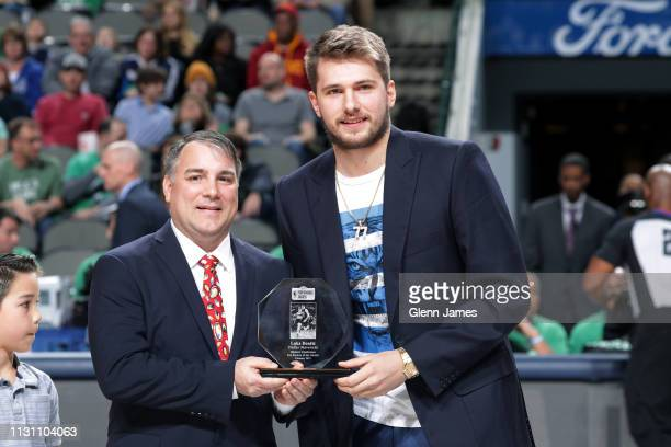 Luka Doncic of the Dallas Mavericks receives the Western Conference Kia Rookie of the Month Award for February 2019 before the game against the...
