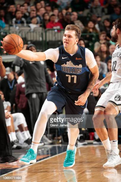 Luka Doncic of the Dallas Mavericks saves a ball from going out of bounds during the game against the Brooklyn Nets on November 21 2018 at the...