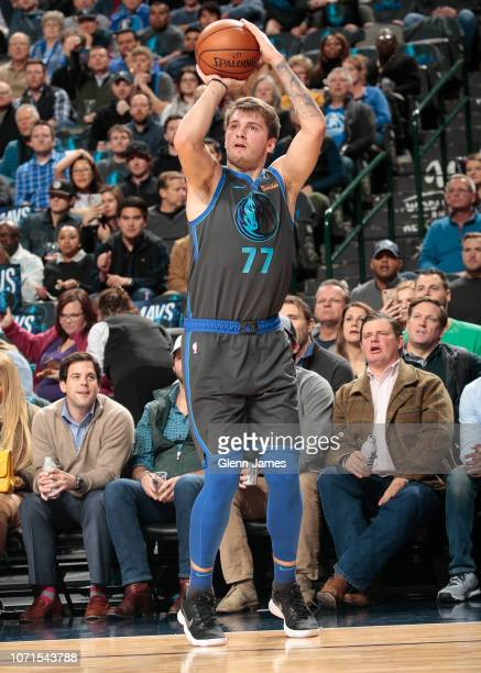 Luka Doncic of the Dallas Mavericks shoots a three pointer during the game against the Orlando Magic on December 10 2018 at the American Airlines...