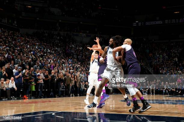 Luka Doncic of the Dallas Mavericks shoots a three pointer for the lead and win against the Minnesota Timberwolves on January 11 2019 at Target...