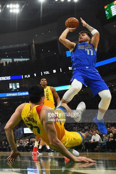 Luka Doncic of the Dallas Mavericks shoots over Ersan Ilyasova of the Milwaukee Bucks during the second half of a game at Fiserv Forum on January 21...