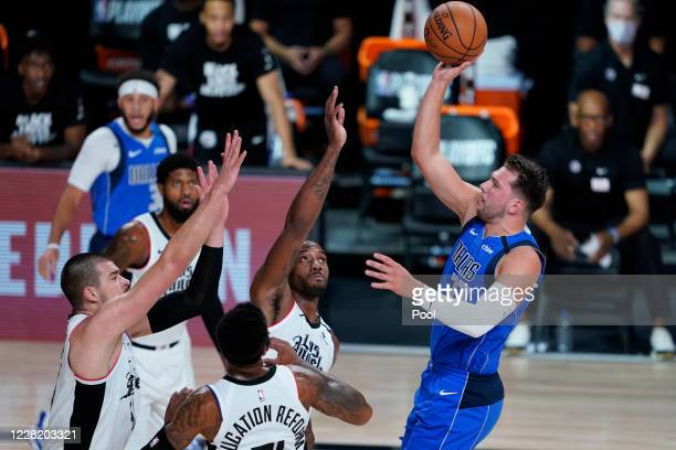 Luka Doncic of the Dallas Mavericks shoots over the Los Angeles Clippers in the first half in game five of the first round of the 2020 NBA Playoffs...
