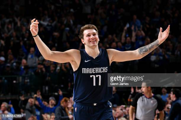 Luka Doncic of the Dallas Mavericks smiles during the game against the Minnesota Timberwolves on December 04 2019 at the American Airlines Center in...