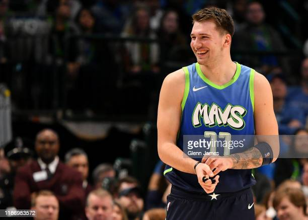 Luka Doncic of the Dallas Mavericks smiles during the game against the New Orleans Pelicans on December 07 2019 at the American Airlines Center in...