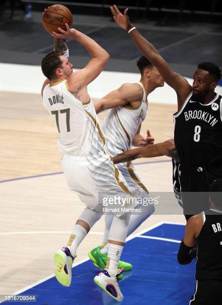 Luka Doncic of the Dallas Mavericks takes a shot against Jeff Green of the Brooklyn Nets in the third quarter at American Airlines Center on May 06,...